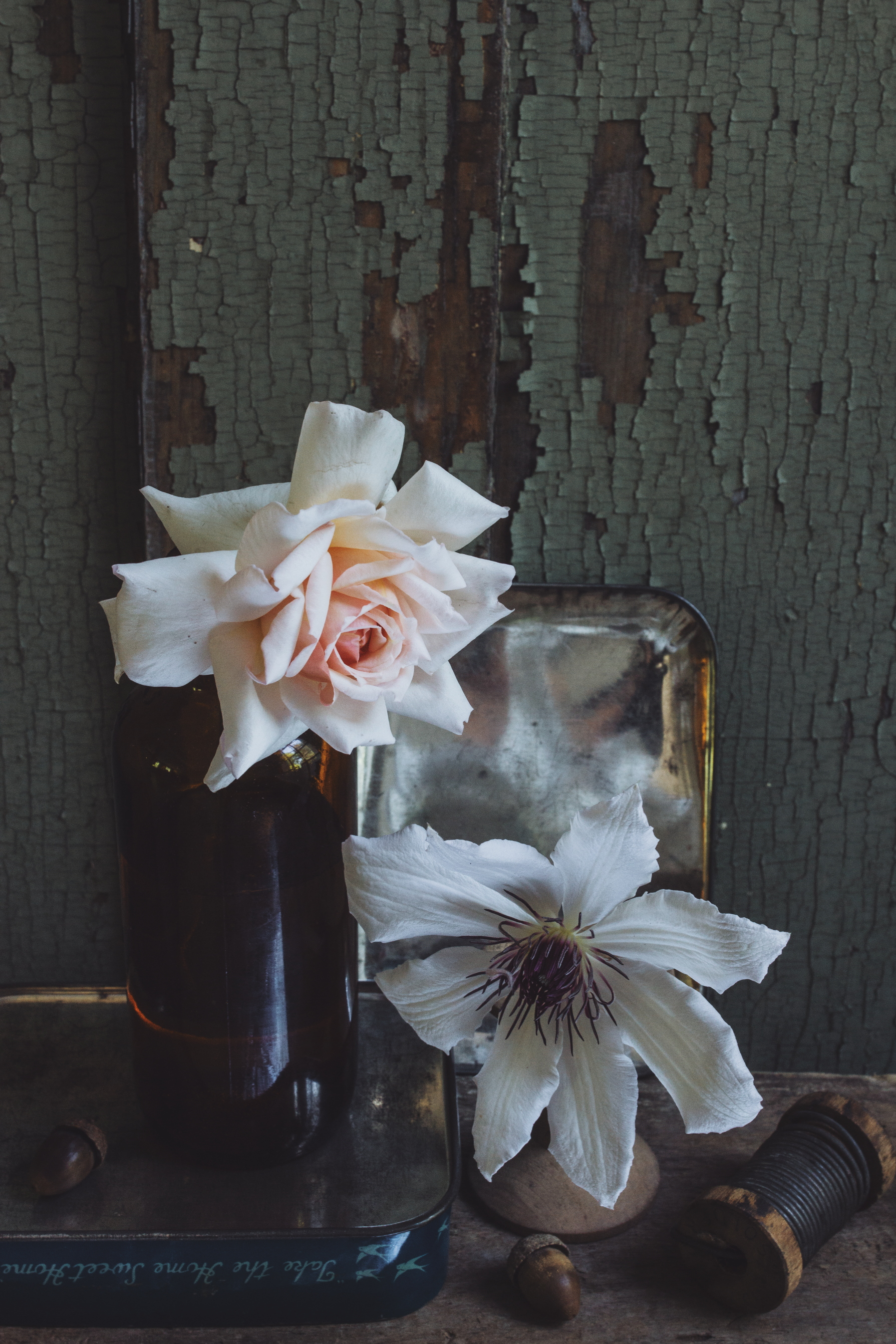 simple stem flower arrangements in vintage bottles