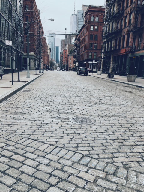 photo of brick paved street in soho new york
