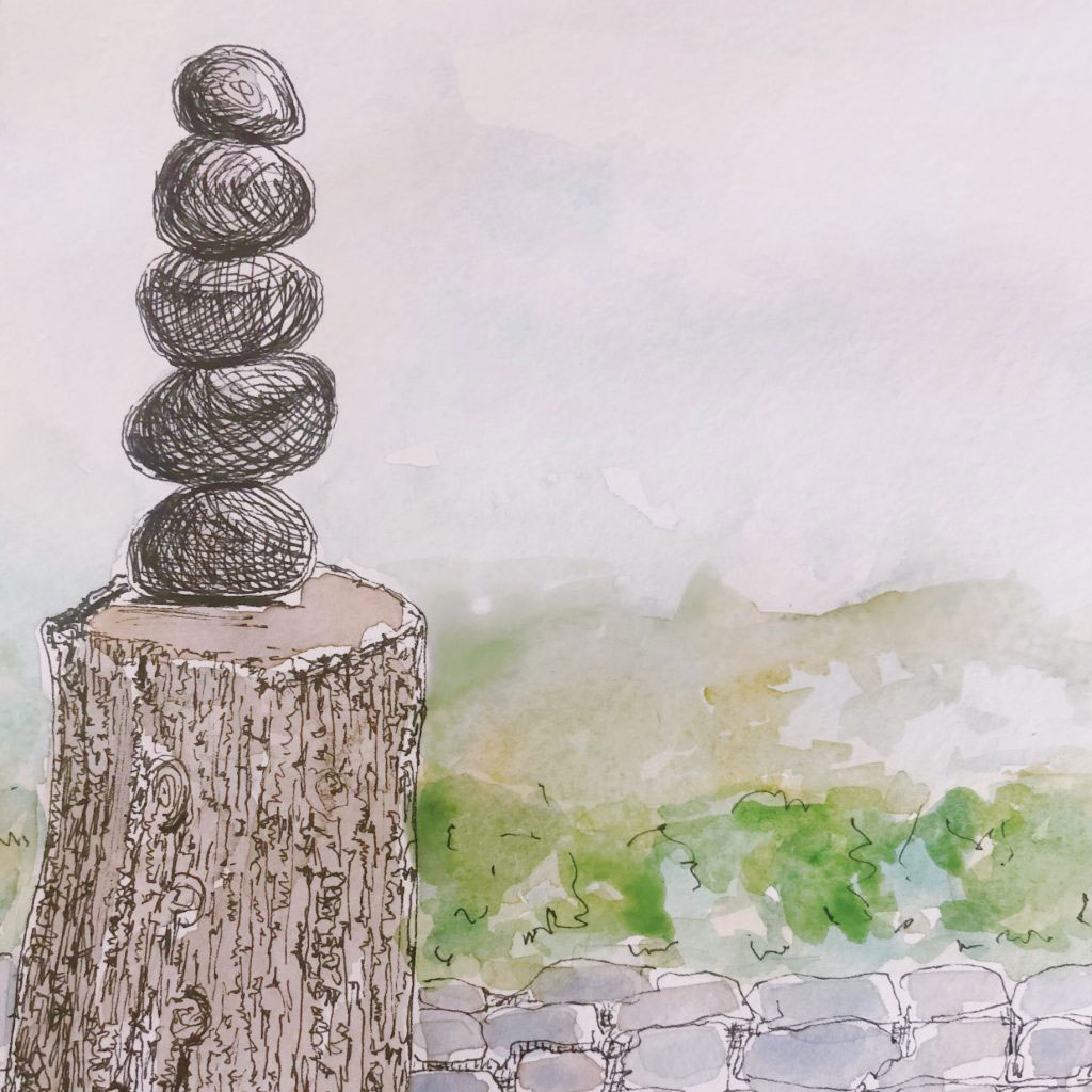 sketch of tree stump and stacked rocks