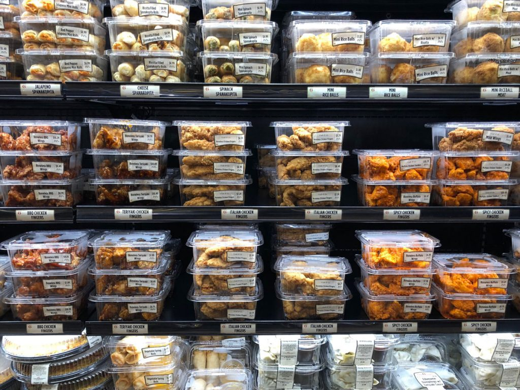 refrigerated display in a grocery store of ready to eat manufactured food