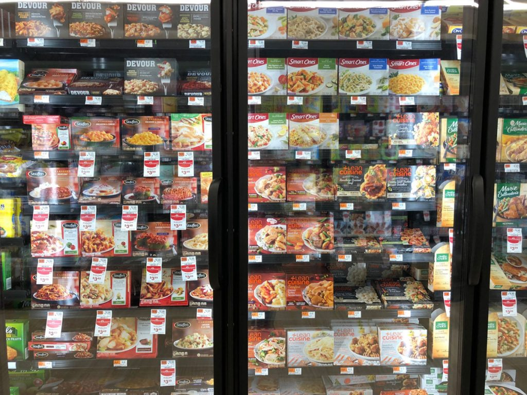 refrigerated display in a grocery store of manufactured food